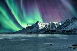 Aurora Borealis, Northern Lights Above of snowy mountain in Lofoten Islands photo