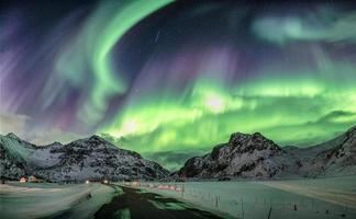 Aurora borealis, Northern lights over snow mountain range photo