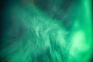 Aurora borealis, Northern lights with stars glowing in the night sky photo