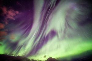 Aurora Borealis Northern lights explosion with stars on night sky at arctic photo