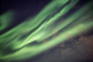 Beautiful green Northern lights, Aurora borealis explosion with starry photo