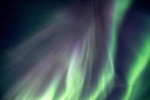 Northern lights, Aurora borealis explosion on night sky photo
