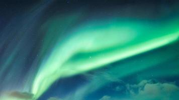 Aurora Borealis, Northern Lights covered in the night sky on Arctic Circle photo