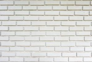 textura desgastada pared de ladrillo blanco foto