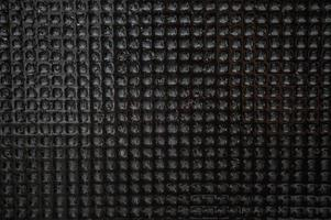 Surface mosaic black stone tiles wet photo
