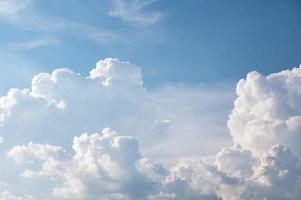 Cumulus white clouds on blue sky photo