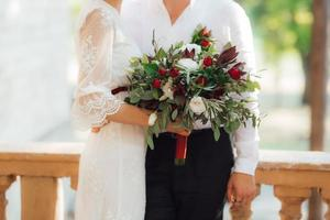 wedding bouquet of red flowers and greenery photo