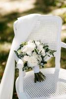 elegant wedding bouquet of fresh natural flowers photo