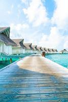 Tropical Maldives resort hotel and island with beach and sea for holiday vacation concept - boost up color processing style photo