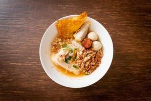 Spicy noodles with fish ball and minced pork or Tom Yum Noodles - Asian food style photo