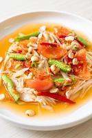 Papaya spicy salad - somtam - Thai traditional street food style photo