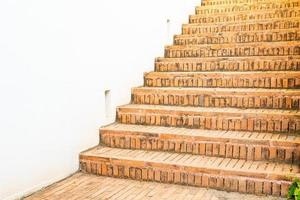 Outdoor brick stair step with white wall photo