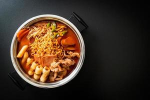 Budae Jjigae or Budaejjigae Army stew or Army base stew. It is loaded with Kimchi, spam, sausages, ramen noodles and much more photo