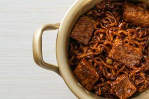 Jjapaguri or Chapaguri, Korean Black Beans Spicy Noodles with Beef photo