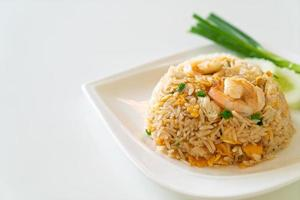 Fried rice with shrimp and crab on white plate photo
