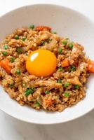 Salmon fried rice with pickled egg on top - Asian food style photo