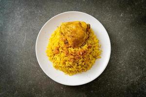 Chicken Biryani or Curried rice and chicken - Thai-Muslim version of Indian biryani, with fragrant yellow rice and chicken photo