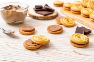 Sandwich cookies with chocolate cream photo
