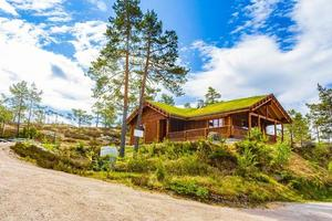 Norwegian wooden cabins cottages in the nature landscape Nissedal Norway. photo