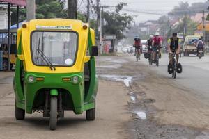 Eco-friendly electronic tuk tuk rickshaw in Luang Prabang Laos. photo