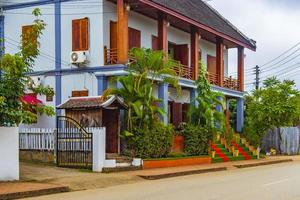 Typical colorful house building in a street Luang Prabang Laos. photo