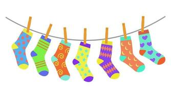 Set of colorful bright children socks drying on the clothesline vector