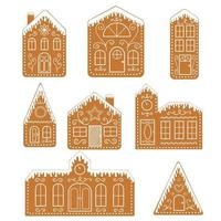Set of isolated gingerbread houses. Traditional Christmas cookies vector