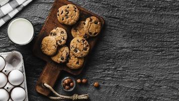 Delicious cookies wooden board glass milk photo