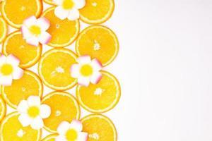 Orange fruit pattern composition. Summer healthy food background. photo