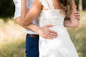 the bride hugs the groom photo