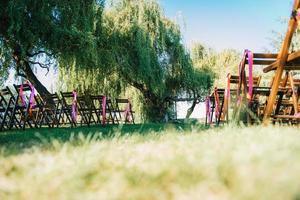 wedding ceremony area, arch chairs decor photo
