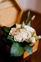 gold wedding rings with a wedding decor photo