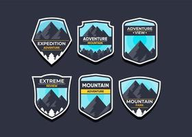 Set the mountain logo and badges. A versatile logo for your business. Vector illustration on a dark background