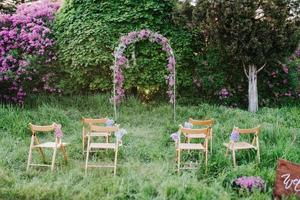 wedding ceremony in the woods among the trees photo