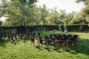 wedding ceremony in the woods among the trees on the green track photo