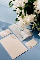 wedding invitation in a blue envelope on a table photo
