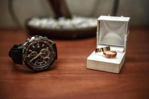 wedding ring in a box and watch the groom photo