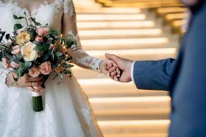 the bride and groom held hands photo