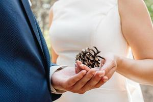 the bride and groom tenderly hold hands between them love and relationships photo