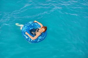 Woman relax on inflatable ring. photo