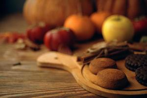 Cookies with pumpkins and apples on the table. photo