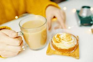 Tartlet and coffee on white table. photo