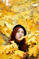 Autumn romantic portrait of a red-haired woman. photo