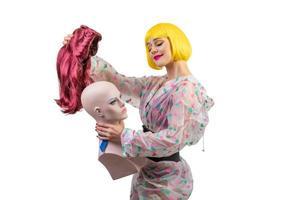 Positive female model holding dummy isolated on white background photo