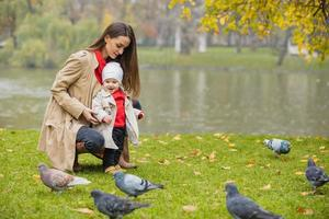Happy family playing outdoors in park, Winter, autumn life photo