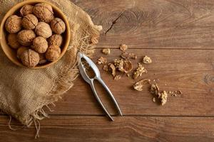 Walnuts kernels in wooden bowl, Walnut healthy food Top view photo
