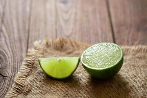 Fresh lime on the brown wooden table photo