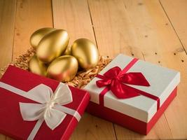 Financial success. Golden egg In a red gift box photo