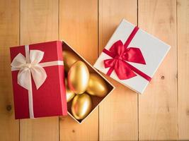 Financial success Golden egg In a red gift box photo