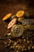 Gold bitcoin physical Bitcoin Cryptocurrency and Gold nugget grains. photo